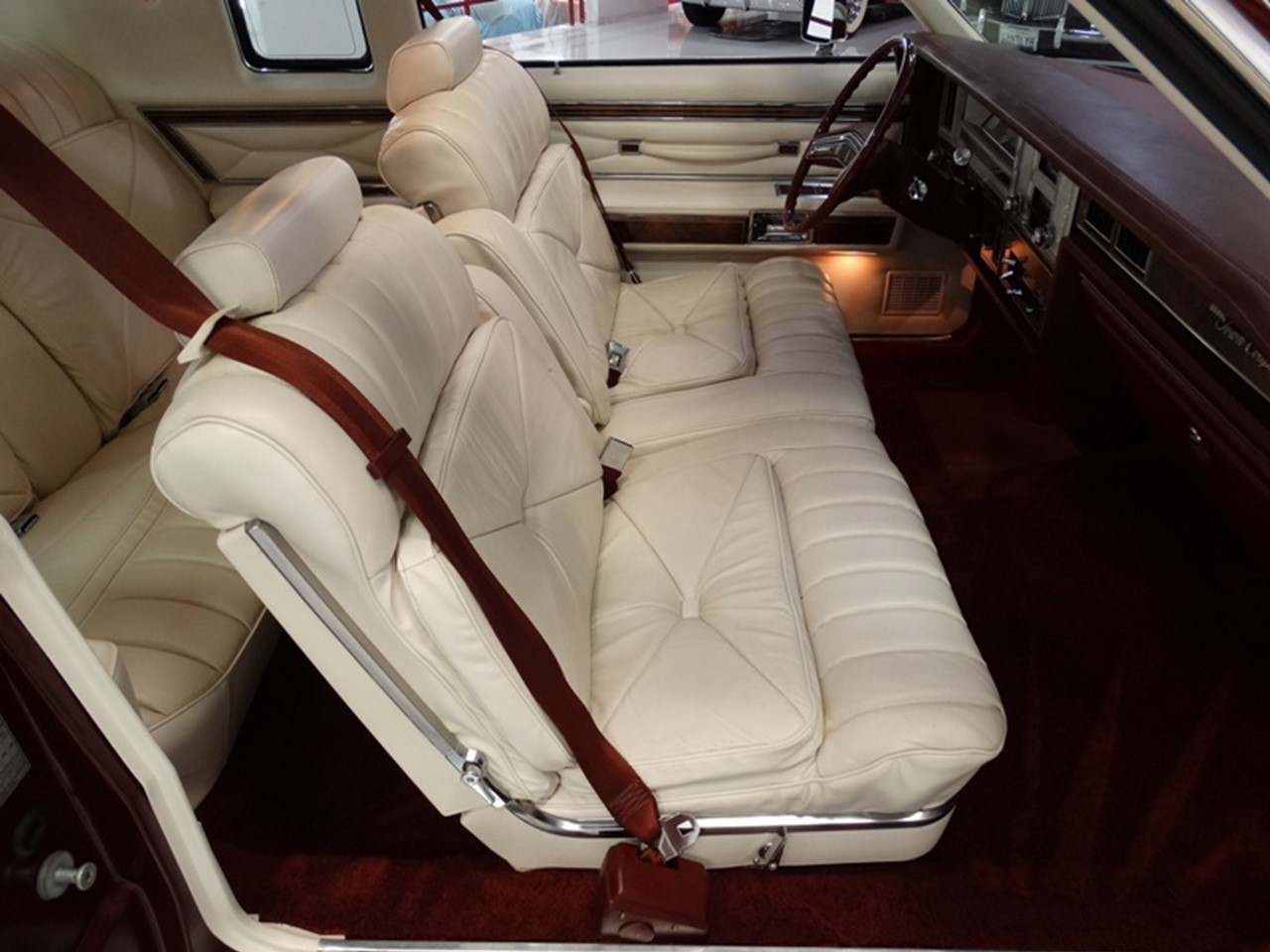 Marvelous photograph of rear seat compartment has a folding center armrest and a bench seat  with #1F0F0C color and 1280x960 pixels